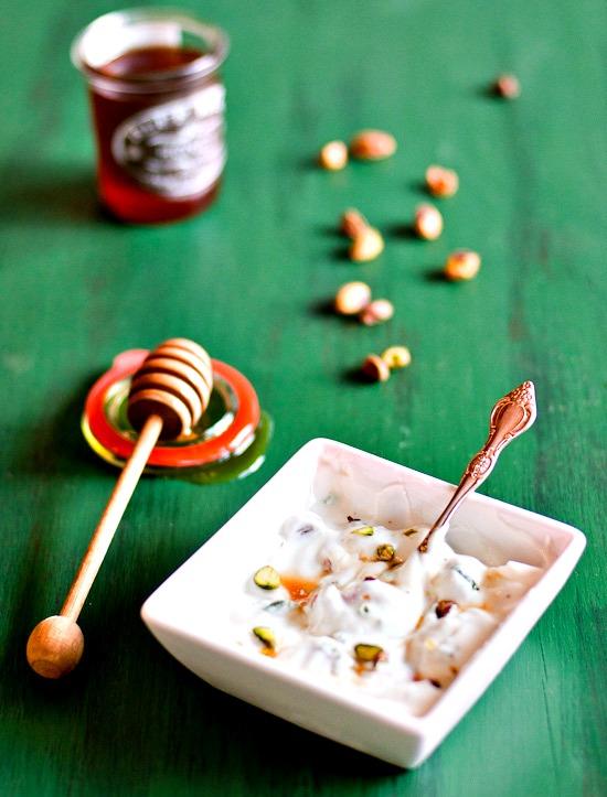 strawberries with yogurt, honey, and pistachios